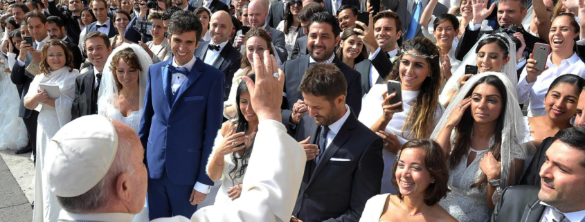 """Pope Francis greets newly married couples during his general audience in St. Peter's Square at the Vatican in this Sept. 30, 2015, file photo. Pope Francis' postsynodal apostolic exhortation on the family, """"Amoris Laetitia"""" (""""The Joy of Love""""), was to be released April 8. The exhortation is the concluding document of the 2014 and 2015 synods of bishops on the family. (CNS photo/L'Osservatore Romano) See stories to come."""